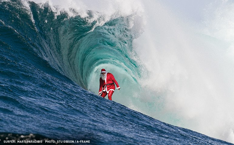 Santa surfing Northshore Pipe!