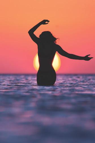 sunset_wading_woman